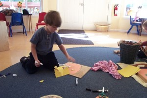 Aiden working independently on his Thanksgiving project.